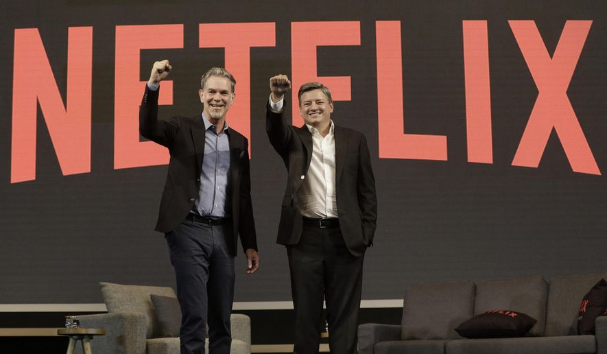 Reed Hastings, left, CEO of Netflix, poses with Ted Sarandos, Chief Content Officer of Netflix, during a press conference in Seoul, South Korea, Thursday, June 30, 2016. Netflix plans to expand its Asian offerings to its subscribers around the world by tapping more creators in Asia. (AP Photo/Ahn Young-joon)