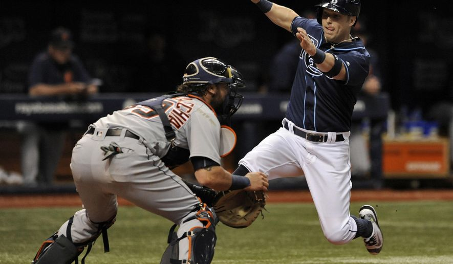 Detroit Tigers catcher Jarrod Saltalamacchia, left, waits for the throw as Tampa Bay Rays' Corey Dickerson, right, scores on Nick Franklin's three-run double during the third inning of a baseball game Thursday, June 30, 2016, in St. Petersburg, Fla. (AP Photo/Steve Nesius)