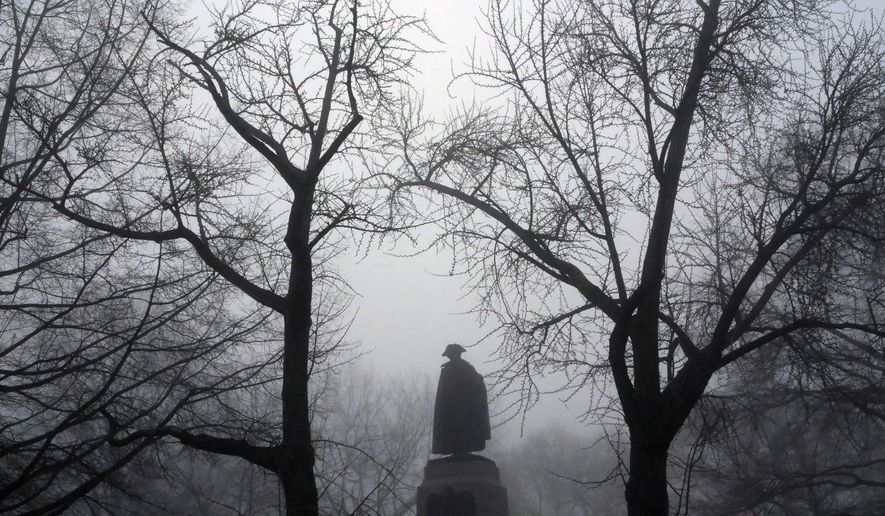 FILE - In this April 1, 2013 file photo a statue of Poland's General Thaddeus Kosciuszko is enveloped in the early morning fog in Lafayette Park across from the White House in Washington. Kosciuszko was a military engineer from Poland, Kosciuszko came to Philadelphia in August 1776 to offer his services in the fight against the British. (AP Photo/Jacquelyn Martin, File)
