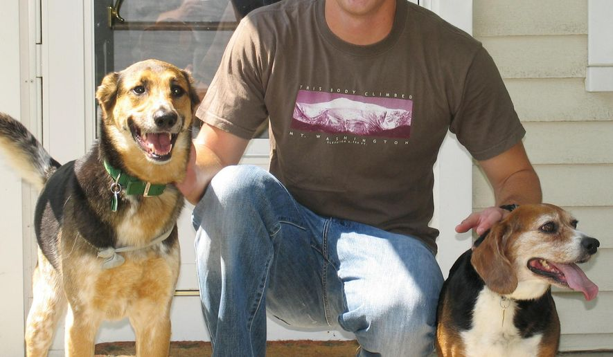 In this undated photo provided by Mark Eisenhauer, Joshua Eisenhauer poses for a photograph with his dogs. When Eisenhauer emptied 24 rounds from his 9mm handgun at police and firefighters responding to a fire in his Fayetteville, N.C., apartment, the former Army sergeant believed he was shooting at the Taliban bomber whose truckload of explosives blew the limbs off his friend, his defenders say. The only place where he belongs is one he can get treatment for his PTSD, said Eisenhauer's father, Mark.  (Mark Eisenhauer via AP)