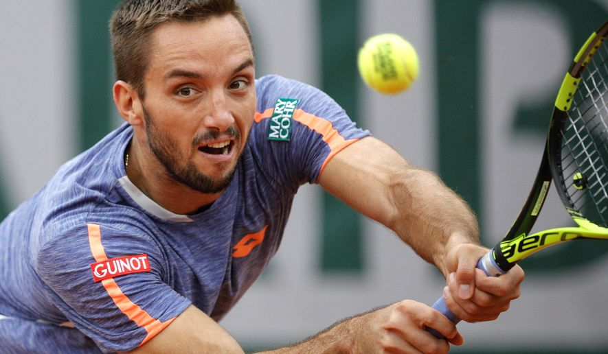 FILE - In this Sunday, May 29, 2016 file photo, Serbia's Viktor Troicki returns the ball to Switzerland's Stan Wawrinka during their fourth round match of the French Open tennis tournament at the Roland Garros stadium, in Paris. Viktor Troicki let the chair umpire, and the rest of the world, know exactly how angry he was about a key call one point from the end of his five-set loss against Albert Ramos-Vinolas of Spain at Wimbledon on Thursday June 30, 2016. (AP Photo/Christophe Ena, File)