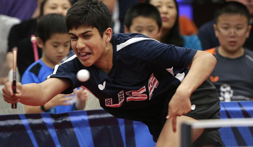 In this June 18, 2016, photo, Kanak Jha returns a shot during an exhibition table tennis match in Dunellen, N.J. Jha's competitive during a match, but easygoing away from the table. He recently trained at the Lily Yip Table Tennis Center in the New York area with his five Olympic teammates and signed autographs for fans. (AP Photo/Julie Jacobson)