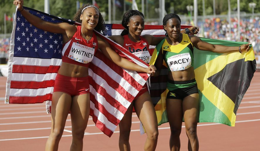 FILE - In this July 24, 2015 file photo, USA's Kaylin Whitney, from left, winning the gold medal, USA's Kyra Jefferson and Jamaica's Simone Facey celebrate after winning the finals of the women's 200 meter run at the Pan Am Games in Toronto. Jefferson won the silver and Facey the bronze. Possible new slogan for the U.S. Olympic track and field team: Higher, Faster, Younger. (AP Photo/Mark Humphrey, File)