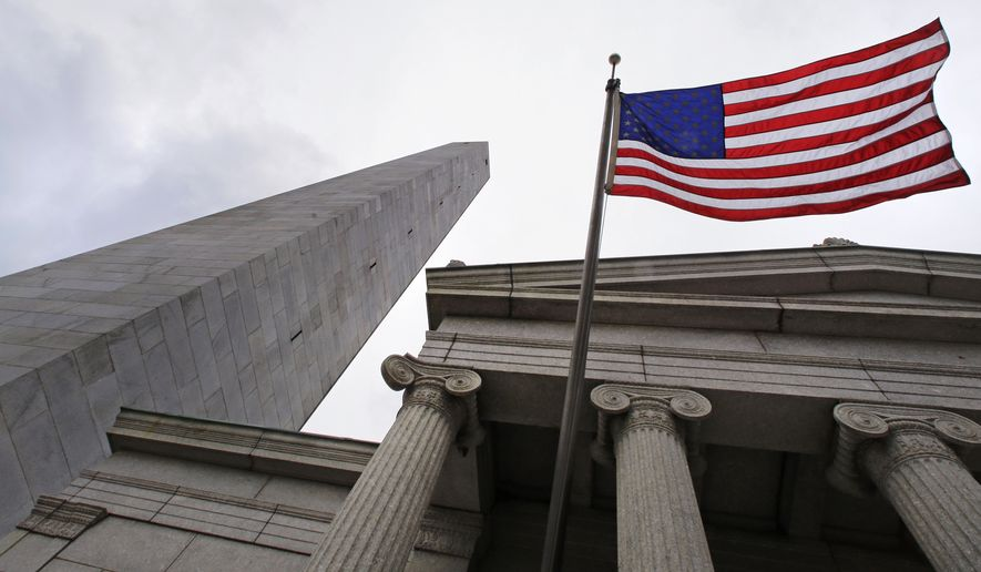 In this Tuesday, June 28, 2016 photo, a flag flies full on a breezy afternoon at the Bunker Hill monument, which is located on Breed's Hill in the Charlestown neighborhood of Boston. The Battle of Bunker Hill, one of the greatest misnomers in U.S. history, is being waged anew on social media. The 1775 battle, a pivotal rallying point for American colonists trying to overthrow British rule, actually was fought on Breeds Hill, not Bunker Hill. (AP Photo/Charles Krupa)