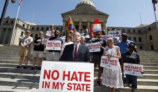 Rob Hill, state director of the Human Rights Campaign Mississippi, speaks on the steps of the Mississippi Capitol in Jackson, Miss., Friday, July 1 2016, as he and others celebrated Thursday's ruling of a federal judge who blocked a Mississippi law on religious objections to same-sex marriage moments before it was set to take effect Friday, ruling it unconstitutionally establishes preferred beliefs and creates unequal treatment for gay people. (AP Photo/Rogelio V. Solis)