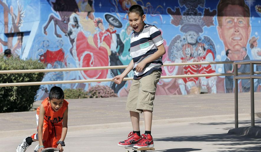 In this March 27, 2016 photo, kids ride around the Chamizal National Memorial in El Paso, Texas, during their Easter outing at the park. (Mark Lambie /The El Paso Times via AP) EL DIARIO OUT; JUAREZ MEXICO OUT; MANDATORY CREDIT  IF USE ON LAM OR LAT AND EL DIARIO DE EL PASO OUT