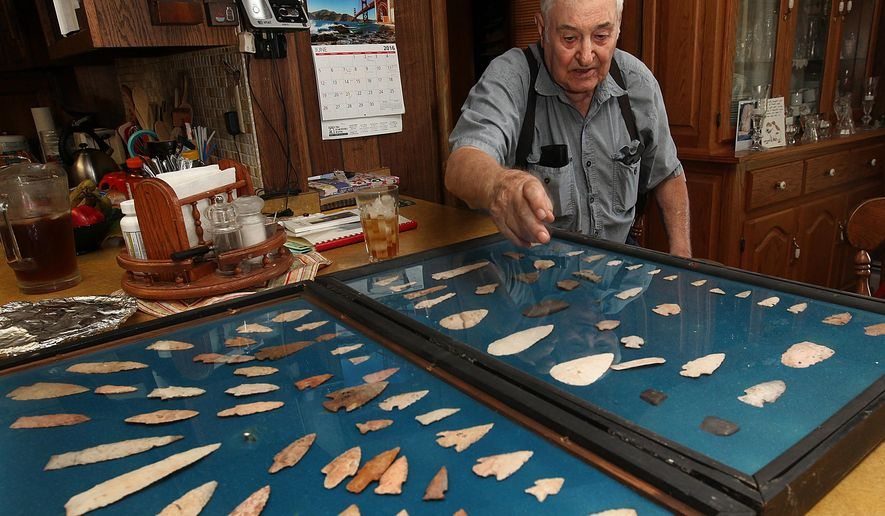 ADVANCE FOR USE SUNDAY JULY 3, 2016 AND THERE AFTER - In this June 7, 2016 photo, longtime arrowhead collector Eddie Johnson points out various aspects of his collection in his rural Pike County, Ill., home. Johnson has been collecting arrowheads since he was a young boy. (Phil Carlson/The Quincy Herald-Whig via AP) MANDATORY CREDIT