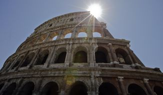 A view of the Colosseum after the first stage of the restoration work was completed in Rome, Friday, July 1, 2016. The Colosseum has emerged more imposing than ever after its most extensive restoration, a multi-million-euro cleaning to remove a dreary, undignified patina of soot and grime from the ancient arena, assailed by pollution in traffic-clogged Rome. (AP Photo/Andrew Medichini)