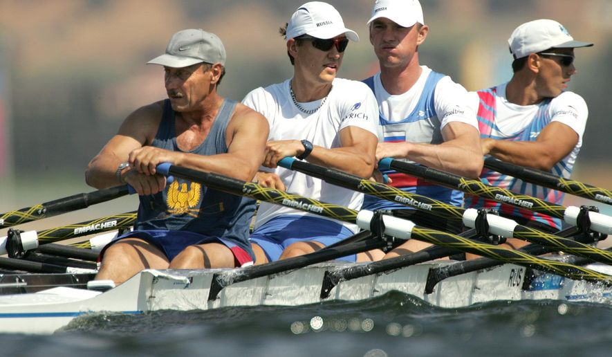 FILE-  In this file photo taken on Tuesday, Aug. 17, 2004, From left: Russia's Sergei Fedorovtsev, Alexeij Svirin, Igor Kravtsov and Nikolai Spinev train for the Men's Quad Sculls event at the 2004 Olympics Games at the Schinias Rowing & Canoeing Center in Schinias near Athens, Greece. The World Rowing Federation says that trimetazidine, a banned substance, was found in a urine sample given by rower Sergei Fedorovtsev in an out-of-competition test on May 17. (AP Photo/Armando Franca, file)