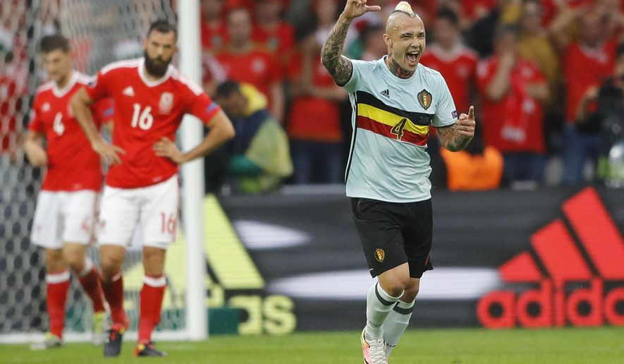 Belgium's Radja Nainggolan celebrates after scoring the opening goal during the Euro 2016 quarterfinal soccer match between Wales and Belgium, at the Pierre Mauroy stadium in Villeneuve d'Ascq, near Lille, France, Friday, July 1, 2016. (AP Photo/Frank Augstein)
