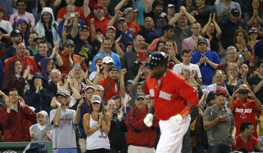 Fans cheer as Boston Red Sox's David Ortiz rounds third base on his solo home run during the fifth inning of a baseball game against the Los Angeles Angels in Boston, Friday, July 1, 2016. (AP Photo/Michael Dwyer)