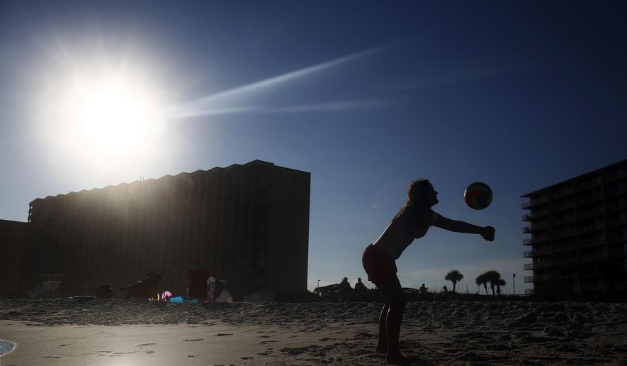 In this, Friday, July 1, 2016, Bevin Walker, 12, of Sylacauga, Ala., plays volleyball near the shoreline with her family in Orange Beach, Ala. (AP Photo/Brynn Anderson) **FILE**