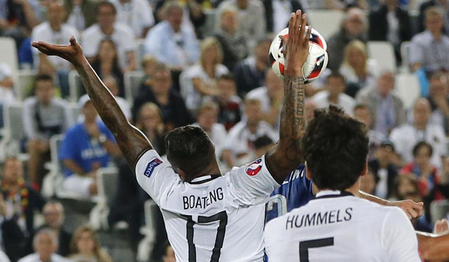 Germany's Jerome Boateng touches the ball with his right hand during the Euro 2016 quarterfinal soccer match between Germany and Italy, at the Nouveau Stade in Bordeaux, France, Saturday, July 2, 2016. (AP Photo/Michael Probst)