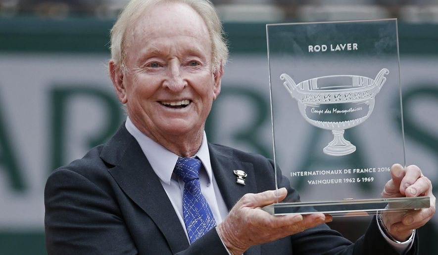 FILE - In this Friday, June 3, 2016 file photo former Australian tennis champion Rod Laver holds an award he received from the French tennis Federation during the French Open tennis tournament at the Roland Garros stadium in Paris, France. (AP Photo/Alastair Grant, File)