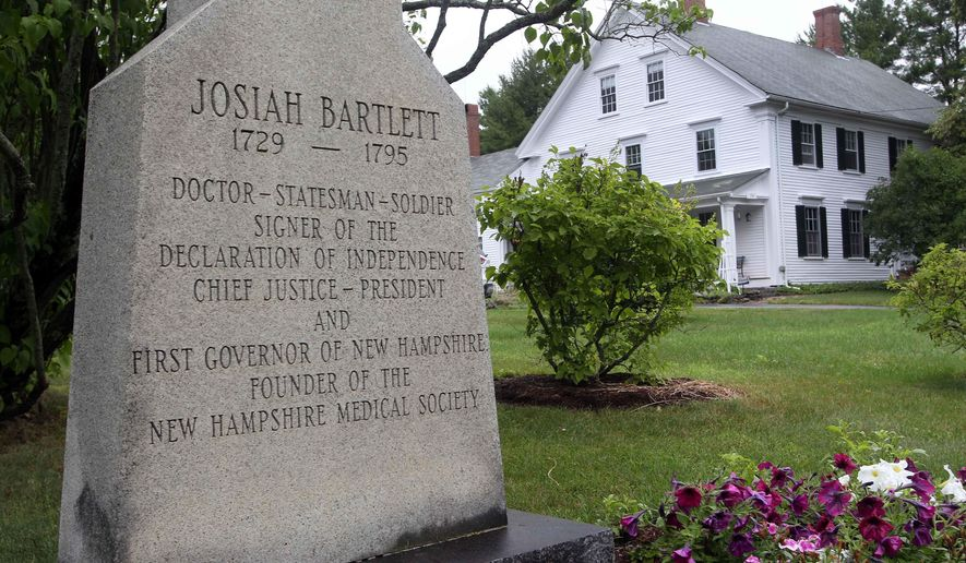 FILE In this Wednesday July 16, 2014 file photo an historic marker is seen in front of the home once owned by Josiah Bartlett, in Kingston, N.H. The home of New Hampshire Declaration of Independence signer, Bartlett, is up for sale after being in the family for seven generations. (AP Photo/Jim Cole, file)