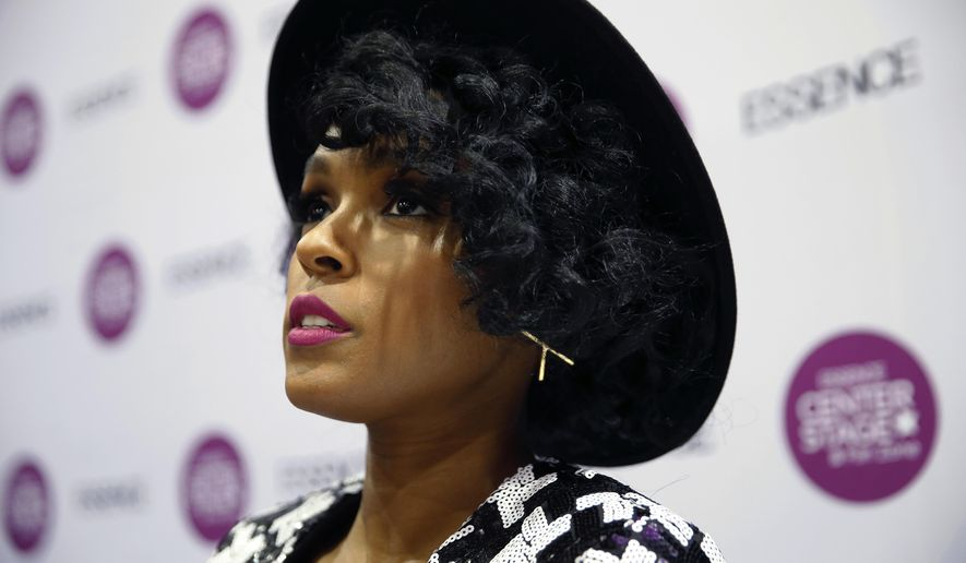 "In this Friday, July 1, 2016 photo, singer Janelle Monae discusses her role in ""Hidden Figures,"" during an interview with The Associated Press at the Essence Festival Expo in New Orleans. The film aims to tell the story of three African-American women who worked at NASA during the 1960s space race. (AP Photo/Gerald Herbert)"