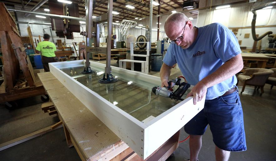 FOR RELEASE SATURDAY, JULY 2, 2016, AT 12:01 A.M. CDT.  - Jim Lauer works on a window Tuesday, June 21, 2016, at Dubuque Window and Door/Adams Architectural Millwork in Dubuque, Iowa.  (Jessica Reilly/Telegraph Herald via AP)