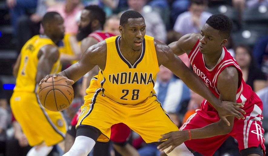 FILE - In this March 27, 2016, file photo, Indiana Pacers center Ian Mahinmi (28) works against Houston Rockets forward Clint Capela during an NBA basketball game in Indianapolis. A person familiar with the deal says that Mahinmi has agreed to sign with the Washington Wizards. The person spoke to The Associated Press on condition of anonymity Saturday, July 2, because NBA free agents are not allowed to sign contracts until July 7. (AP Photo/Doug McSchooler, File)
