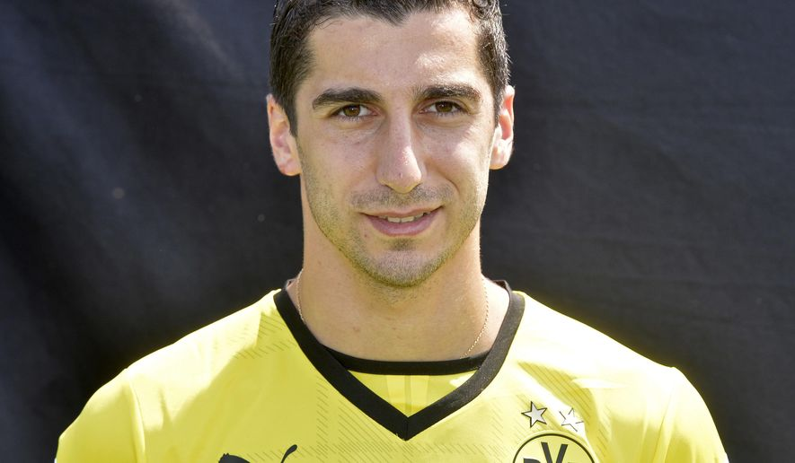 FILE - In this July 9, 2013 file picture Dortmund's player Henrikh Mkhitaryan from Armenia poses at a media event of Borussia Dortmund  in Dortmund, Germany,   Borussia Dortmund says Saturday July 2, 2016  midfielder Henrikh Mkhitaryan is joining Manchester United, becoming Jose Mourinho's third signing as manager.  The 27-year-old Armenia international has been sold to the 20-time English champions as he had only one year remaining on his Dortmund contract.  (AP Photo/Martin Meissner,file)