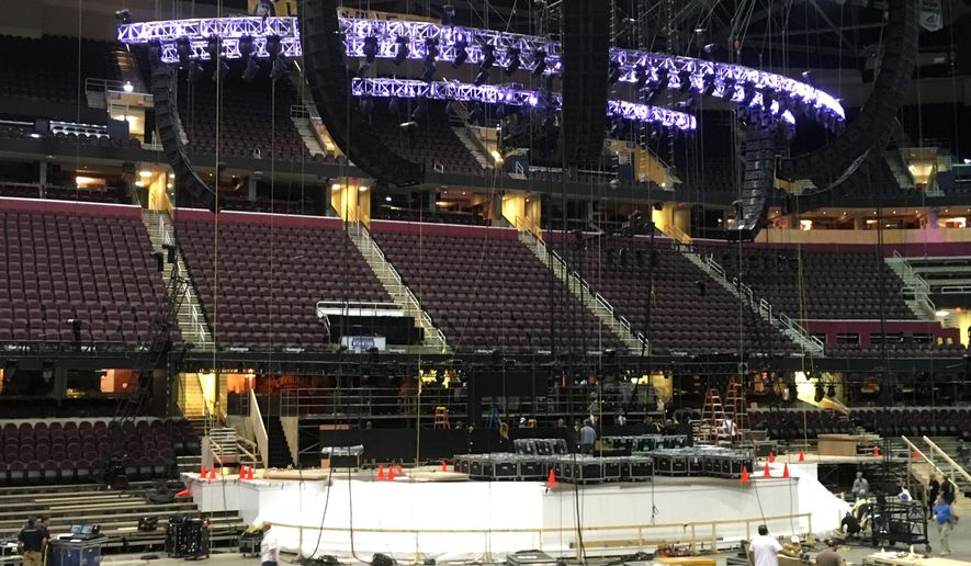 FILE - In this June 28, 2016 file photo, work continues on the main stage for the Republican National Convention in Cleveland. (AP Photo/Mark Gillispie)