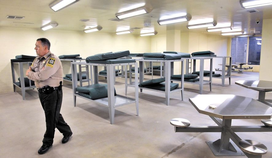 Jail Commander Dan Penland walks through the Jackson County Jail on June 28, 2016 in Medford, Ore. Police and prosecutors are working to keep domestic violence perpetrators locked up longer if a questionnaire turns up red flags. (/The Medford Mail Tribune via AP)