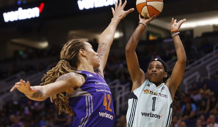 Phoenix Mercury's Brittney Griner (42) jumps to contest a shot from New York Liberty's Shavonte Zellous (1) during the first half of a WNBA basketball game Friday, July 1, 2016, in Phoenix. (Patrick Breen/The Arizona Republic via AP)