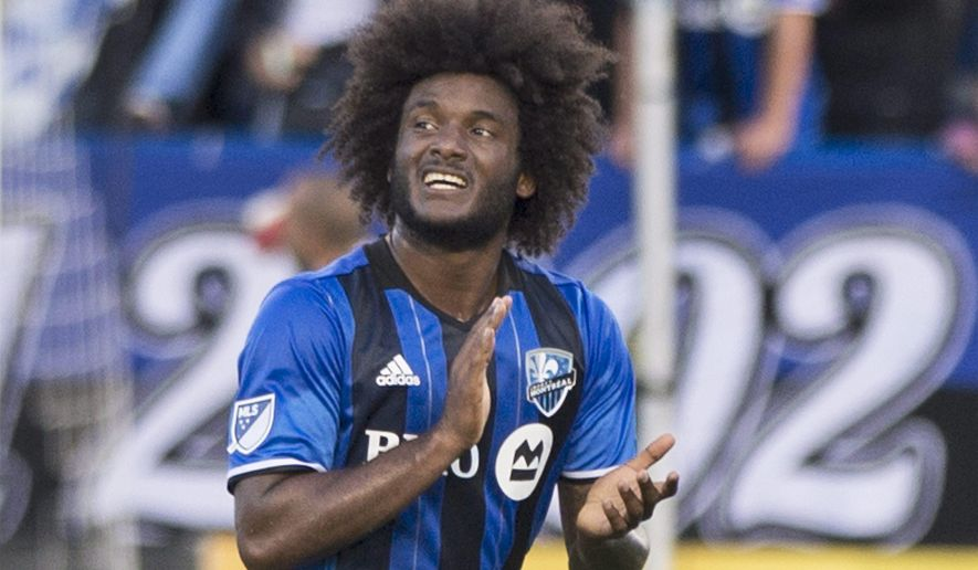 Montreal Impact's Michael Salazar salutes supporters after being taken off during the second half of an MLS soccer match against the New England Revolution in Montreal on Saturday, July 2, 2016. (Graham Hughes/The Canadian Press via AP)