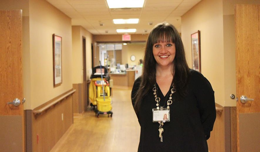 This June 23, 2016 photo shows Jenna Heim, director of nursing at Oakwood Village Prairie Ridge in Madison, Wisc. Heim has phased out use of personal alarms and other long-used fall preventions like fall mats and low beds in favor of more proactive care. The changes, which took effect in June, are part of a nationwide movement to eliminate such measures. (AP Photo by Bryna Godar).