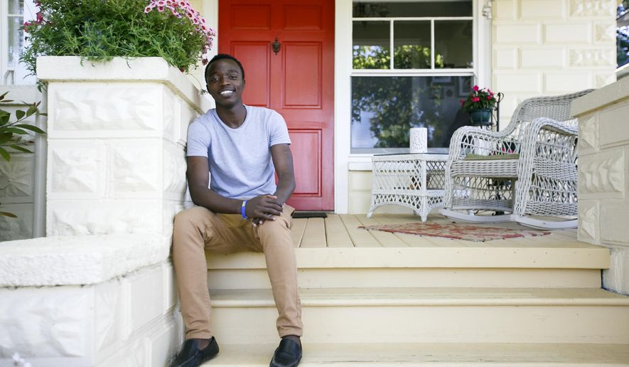 ADVANCE FOR THE WEEKEND OF JULY 2-3 AND THEREAFTER - Joel Nzabakiza, seen in a June 6, 2016 photo, came to Salem as a refugee in April 2015 due to the conflict in his home country of Democratic Republic of Congo. His mother and five brothers resettled in the states as well, and now live with relatives in Texas. Joel stayed in Salem to earn his diploma from McKay High School. (Molly J. Smith/Statesman-Journal via AP) MANDATORY CREDIT