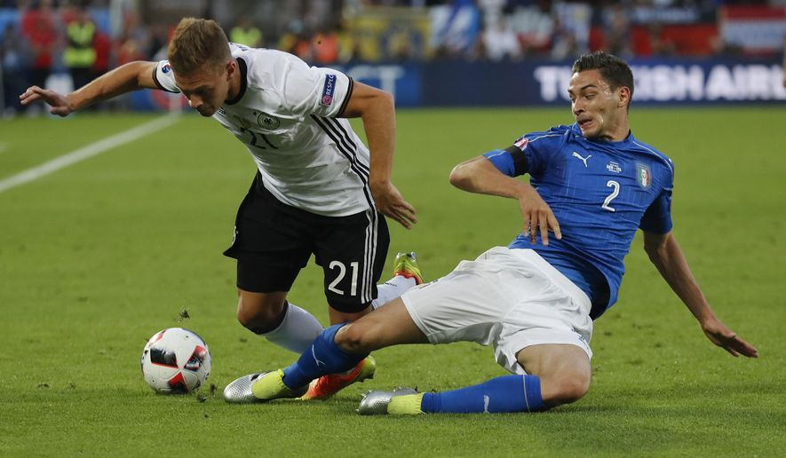 Italy's Mattia De Sciglio, right, challenges Germany's Joshua Kimmich during the Euro 2016 quarterfinal soccer match between Germany and Italy, at the Nouveau Stade in Bordeaux, France, Saturday, July 2, 2016. (AP Photo/Antonio Calanni)