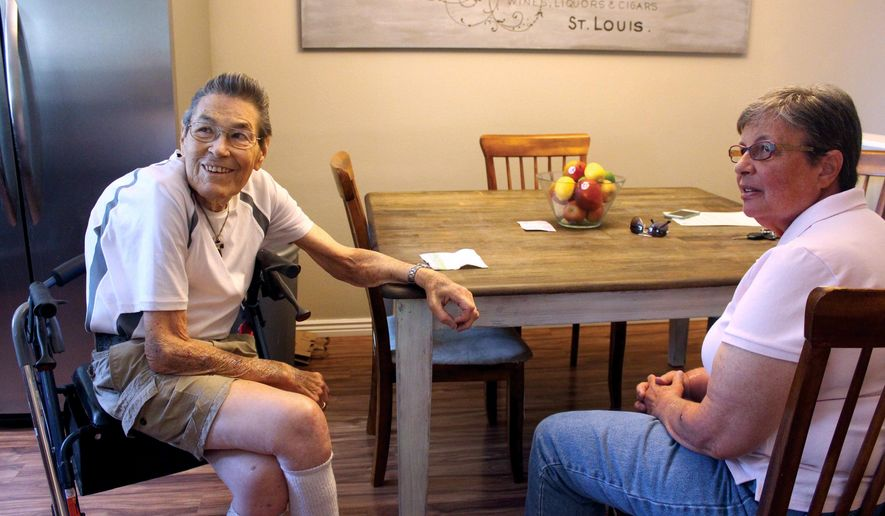 ADVANCE FOR SATURDAY, JULY 2 AND THEREAFTER - In this Friday, June 17, 2016 photograph, Lindsay Bethel, right, chats with Robert Green in his residence in the Denver suburb of Aurora, Colo. Bethel gives Green rides to his weekly appointments at the University of Colorado Cancer Center as part of the American Cancer Society's Road to Recovery program that provides transportation to patients who need help to get to cancer treatments. (Susan Gonzalez/Aurora Sentinel via AP)