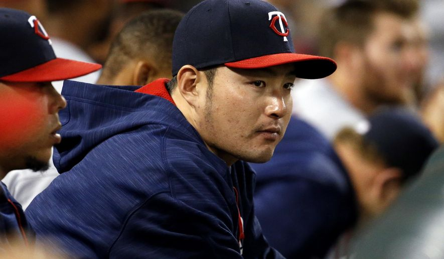 FILE - In this Wednesday, June 29, 2016, file photo, Minnesota Twins' Byung Ho Park, of South Korea, watches from the dugout during the eighth inning of a baseball game against the Chicago White Sox in Chicago. Park came into MLB as a Korean baseball star, but he's playing more like a rookie,  hitting .191 through his first 62 games.(AP Photo/Nam Y. Huh, File)
