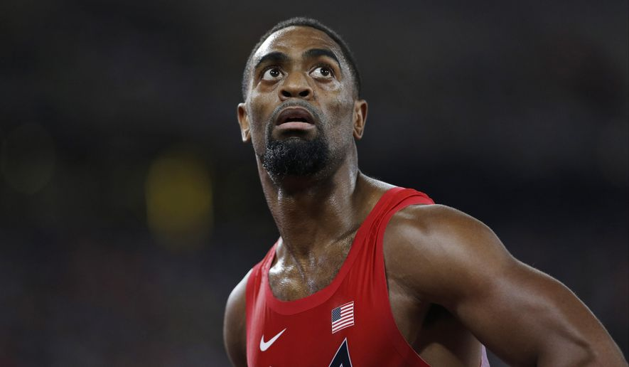 FILE - In this Aug. 23, 2015, file photo, United States' Tyson Gay looks at his time from a men's 100-meter semifinal at the World Athletics Championships at the Bird's Nest stadium in Beijing. The man who used to be considered the biggest threat to Usain Bolt is now often viewed as a bit player in the sprint game. Fine with him, he insists. He's making one last run at the Olympics, doing it for himself and nobody else. (AP Photo/David J. Phillip, File)