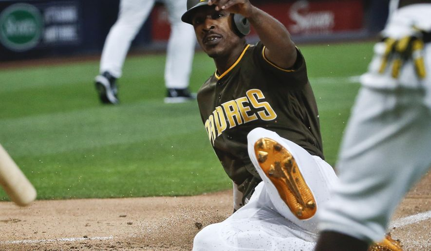 San Diego Padres' Melvin Upton Jr. slides safely into home while scoring against the New York Yankees on a double by Derek Norris in the first inning of a baseball game Friday, July 1, 2016, in San Diego. (AP Photo/Lenny Ignelzi)