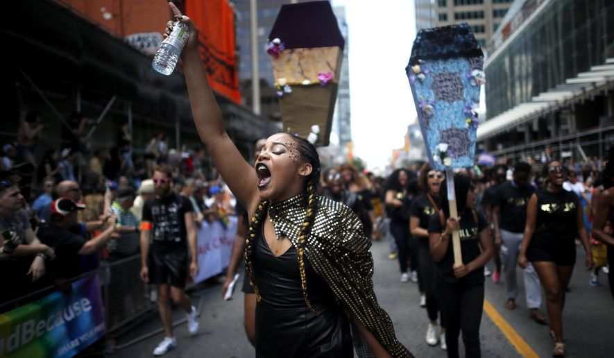 Members of Black Lives Matter Toronto take part in the annual Pride Parade in Toronto on Sunday, July 3, 2016. (Mark Blinch/The Canadian Press via AP)