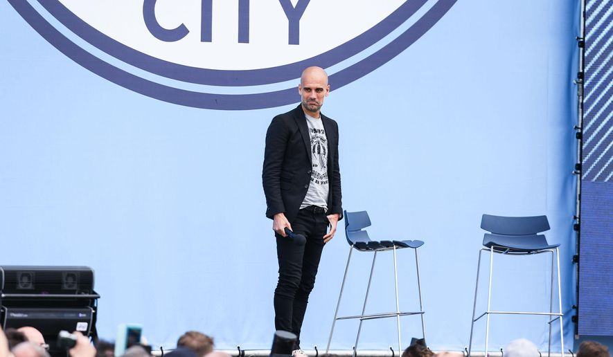 English soccer club Manchester City's new manager Pep Guardiola is unveiled to fans at the Etihad Stadium, Manchester, England, Sunday July 3, 2016. (Barrington Coombs/PA Wire via AP)
