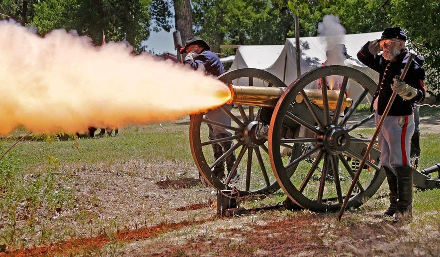 In this June 22, 2016 photo, a historic 12-pound howitzer from Fort Phil Kearny in Wyoming is fired at the U.S. Cavalry School, in Crow Agency, Mont. (Bob Zellar /The Billings Gazette via AP)