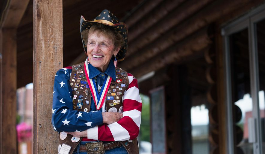 "In this Thursday, June 23, 2016 photo, Marilyn ""Micki"" Robison poses for a photo in Naches, Wash. Robison was the wagon master on one of the Conestoga wagons in the bicentennial wagon train that came across the U.S. almost 40 years ago. Robison wore a leather vest with pins from all the states she visited during the pilgrimage. (Sofia Jaramillo/Yakima Herald-Republic via AP) MANDATORY CREDIT"