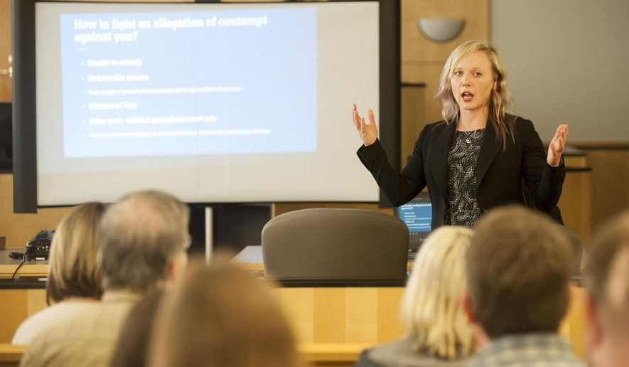 ADVANCE FOR WEEKEND EDITIONS, JULY 2-3 - In this photo taken June 15, 2016, attorney Amber Rush teaches a free class to the public at the Clark County Courthouse in Vancouver, Wash. Navigating the family law system can be an overwhelming and emotional process, especially for people who have no choice but to represent themselves in court.  Local and state agencies recognize a strong need for assistance and have begun offering alternatives to help guide the public through the process, reported The Columbian. (Natalie Behring/The Columbian via AP)