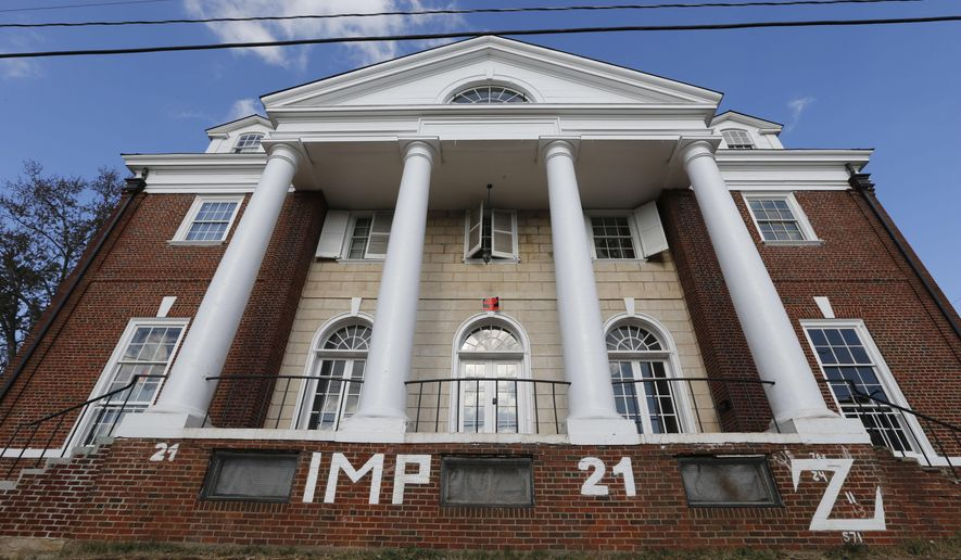 This Nov. 24, 2014, file photo shows the Phi Kappa Psi house at the University of Virginia in Charlottesville, Va. Hundreds of pages of notes, emails and other documents, released Friday, July 1, 2016, shed light on the reporting and fallout of a now-discredited Rolling Stone magazine article about a rape at the university. (AP Photo/Steve Helber, File)