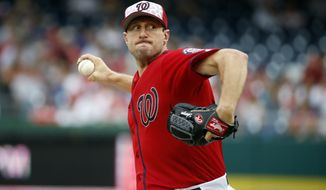 Washington Nationals starting pitcher Max Scherzer throws during a baseball game against the Milwaukee Brewers at Nationals Park, Monday, July 4, 2016, in Washington. (AP Photo/Alex Brandon)