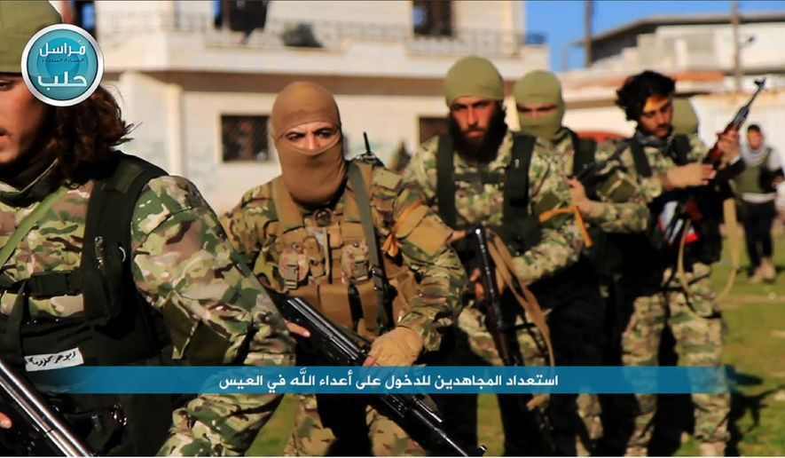This file photo posted on the Twitter page of Syria's al-Qaida-linked Nusra Front on April 1, 2016, shows fighters from al-Qaida's branch in Syria, the Nusra Front, marching toward the northern village of al-Ais in Aleppo province, Syria. (Al-Nusra Front via AP, File)