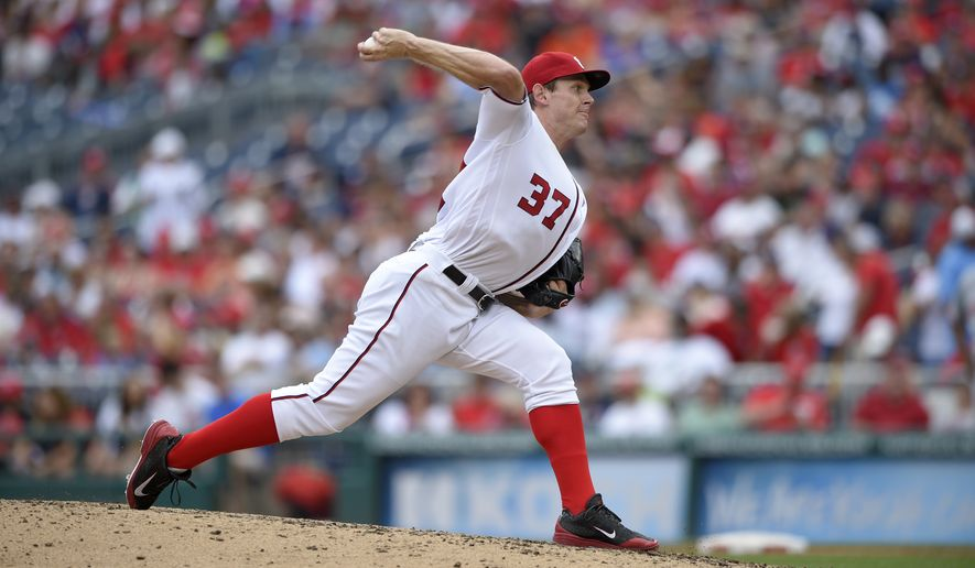 Washington Nationals starting pitcher Stephen Strasburg delivers a pitch during a baseball game against the Cincinnati Reds, Sunday, July 3, 2016, in Washington. (AP Photo/Nick Wass)
