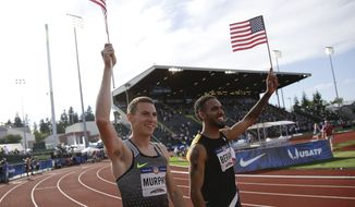 Clayton Murphy, left, winner, and Boris Berian, in second place, celebrate after men's 800-meter final at the U.S. Olympic Track and Field Trials, Monday, July 4, 2016, in Eugene Ore.(AP Photo/Marcio Jose Sanchez)
