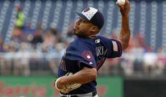 Milwaukee Brewers starting pitcher Junior Guerra throws during the first inning of a baseball game against the Washington Nationals at Nationals Park, Monday, July 4, 2016, in Washington. (AP Photo/Alex Brandon)