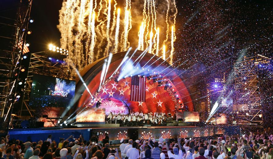 Fireworks shoot from the Hatch Shell during rehearsal for the annual Boston Pops Fireworks Spectacular on the Esplanade in Boston, Sunday, July 3, 2016. (AP Photo/Michael Dwyer)
