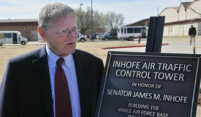 In this March 4, 2016, file photo, U.S. Sen. James Inhofe stands next to a plaque bearing his name after a dedication ceremony for the new air traffic control town at Vance Air Force Base in Enid, Oklahoma. Severe weather forced Inhofe to land an airplane at a small airport in Oklahoma, his spokeswoman said Sunday night, July 3, 2016. (Billy Hefton/The Enid News & Eagle via AP, File)