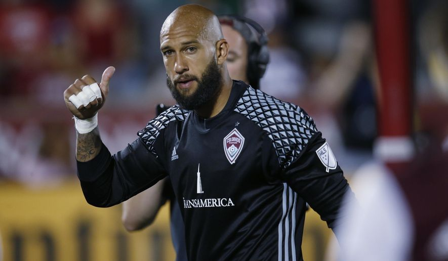 Colorado Rapids goalkeeper Tim Howard gestures to fans a he leaves the pitch after facing the Portland Timbers in the second half of an MLS soccer match Monday, July 4, 2016, in Commerce City, Colo. The teams played to a 0-0 tie. (AP Photo/David Zalubowski)