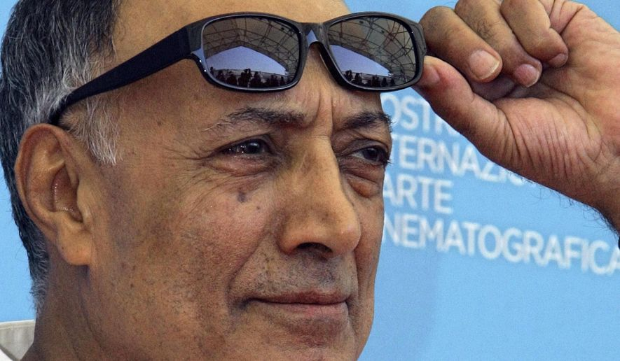 "FILE - In an Aug. 28, 2008 file photo, acclaimed Iranian film director Abbas Kiarostami poses during the photo call of his movie 'Shirin' (My sweet Shirin) at the 65th edition of the Venice Film Festival in Venice, Italy.  Iran's official news agency IRNA says Kiarostami, whose 1997 film ""Taste of Cherry"" won the Palme d'Or,  died Monday, July 4, 2016, in Paris, where he had gone for cancer treatment. He was 76.  (AP Photo/Domenico Stinellis, File)"