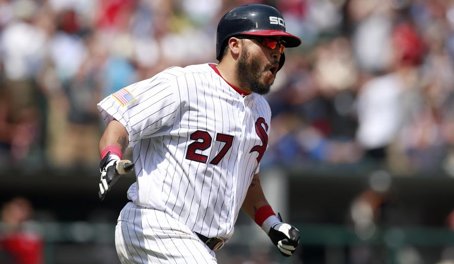 Chicago White Sox's Dioner Navarro (27) reacts after hitting a two-run home run during the fifth inning of a baseball game against the New York Yankees in Chicago, on Monday, July 4, 2016. (AP Photo/Jeff Haynes)